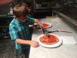 Amaretto Ristorante Making Pizza